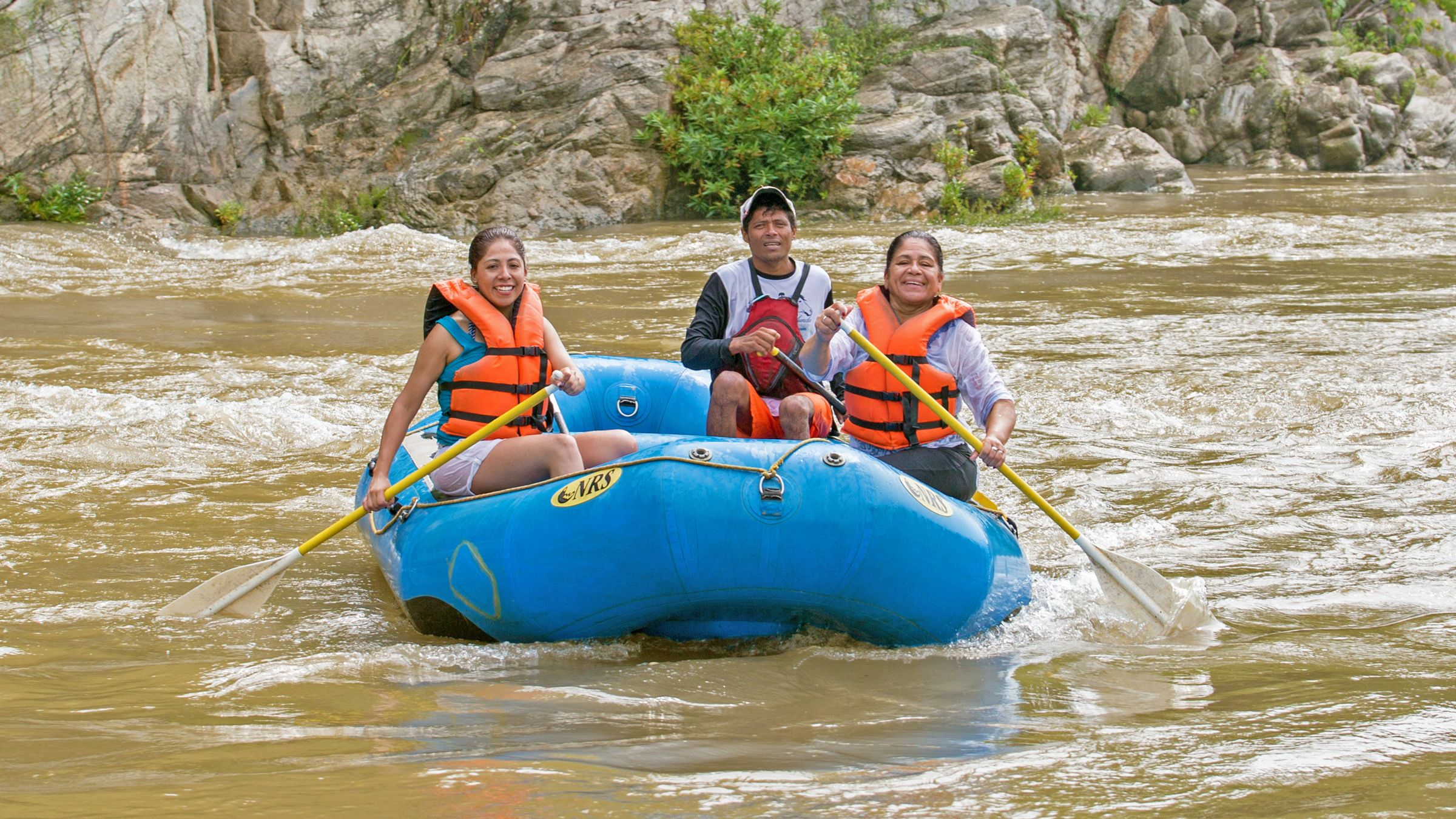 group of three rafters paddle down Rio Copalita