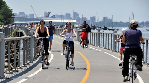 Bicyclists on a path at Hudson River Park in New York