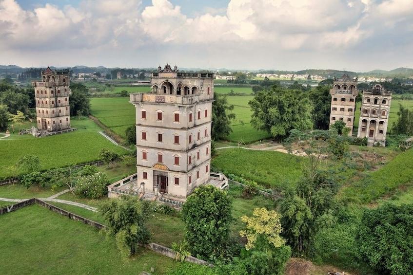 Show item 1 of 5. Kaiping UNESCO Diaolou & Li Garden Tour from Guangzhou