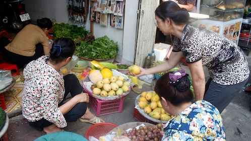 Buying produce in a Hanoi street market