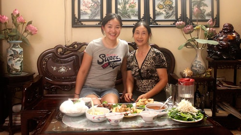 Two Hanoi Locals pose with completed meal