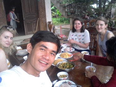 Group enjoying a meal on the Cambodian Cooking tour at a Local's House Siem Reap