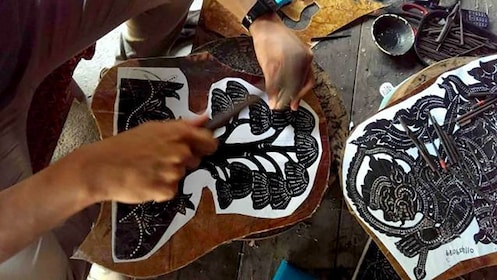 Leather worker is nailing pattern into leather