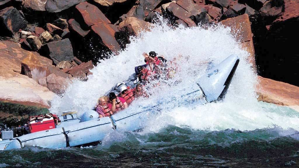 Water splashing against the rocks on the Colorado River White Water Rafting
