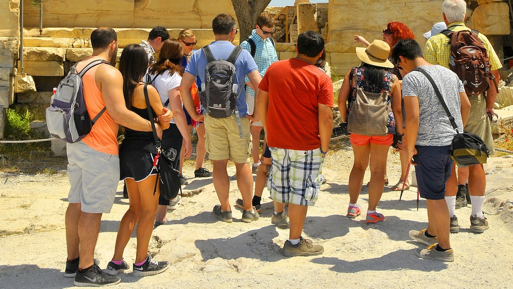 Tour group admiring a historical site in Athens