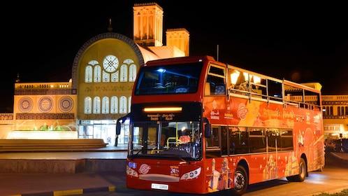 double decker tour bus at night in Dubai