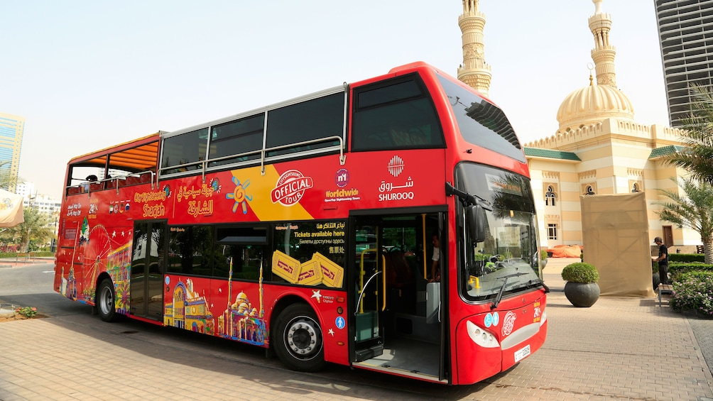Show item 3 of 6. double decker touring bus in city of Dubai