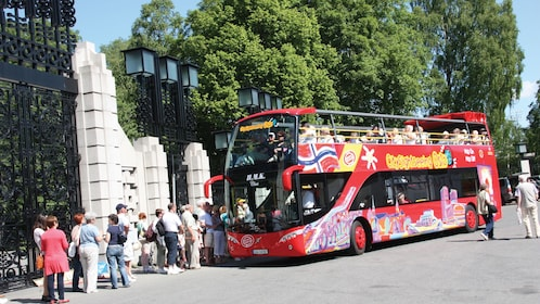 Guests embark on a tour around Oslo on a double decker bus