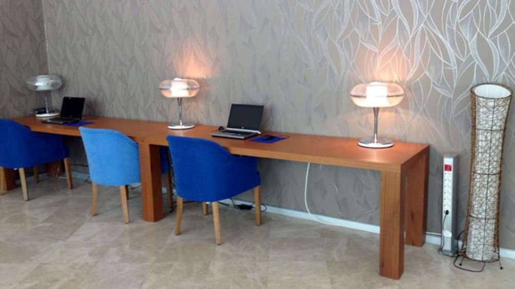 Desks and workstations inside the Izmir Domestic Comfort Lounge in Istanbul