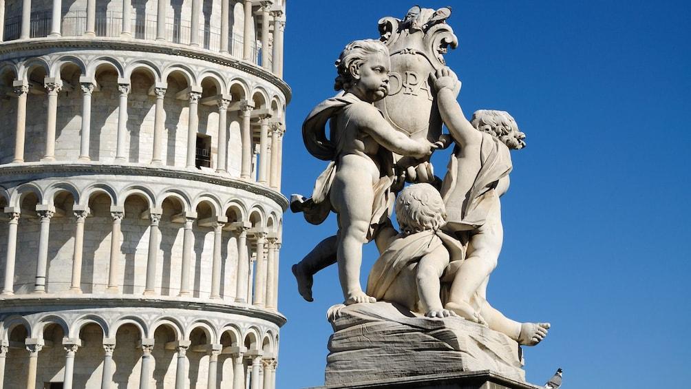 Close up of sculptures in front of Pisa.