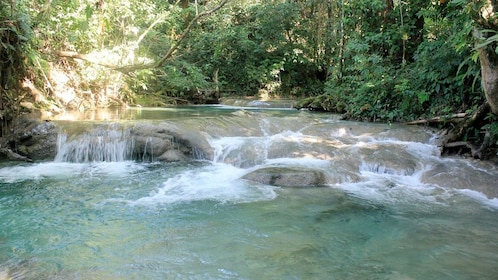 Waterfall view seen on the Mayfield Falls River Walk in South Coast, Jamaica