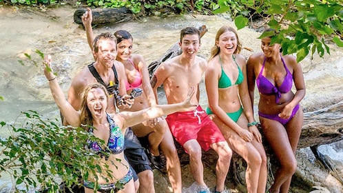 Group relaxing on the Nine Mile and Dunns River Falls tour in South Coast, Jamaica