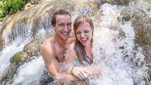 Couple enjoying the Nine Mile and Dunns River Falls tour in South Coast, Jamaica