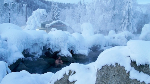 Man soaking in the hot springs in Fairbanks