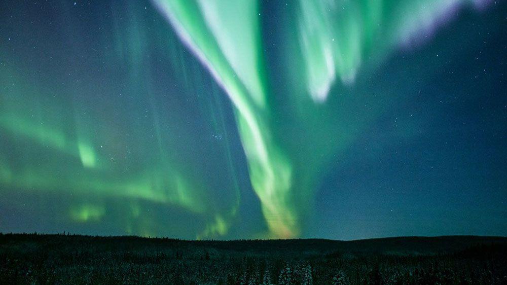 Northern Lights travel across sky in Fairbanks