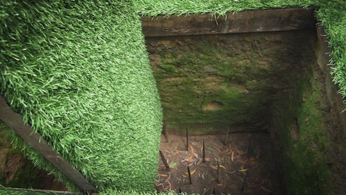 Close up view of tunnel with spikes at bottom.