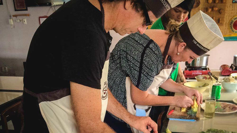 Group members in pitching preparing food in cooking class.