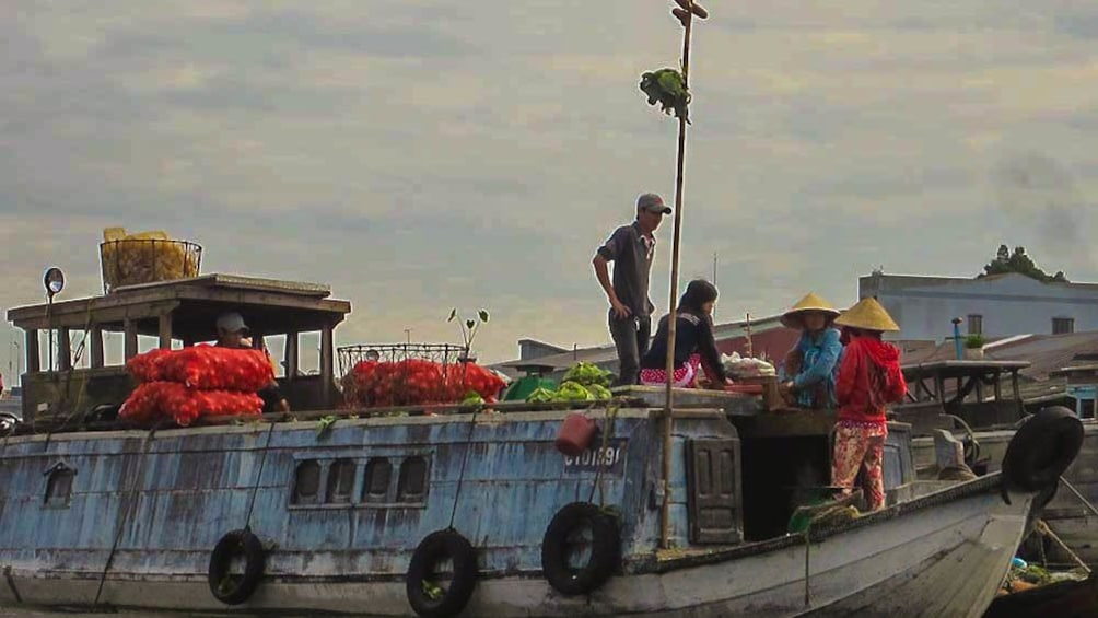 Show item 2 of 8. View of boats in river during cloudy day with fresh produce loaded on them.