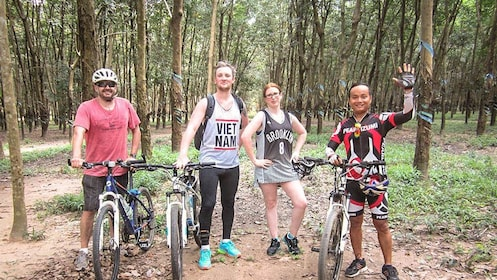 Cycling group posing together near Cu Chi tunnels.