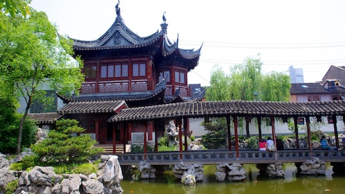 Temple and bridge over a pond at the Yu Yuan Garden in Shanghai