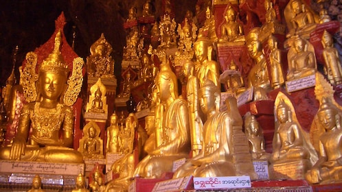 Close up of golden sculptures of religious figures.