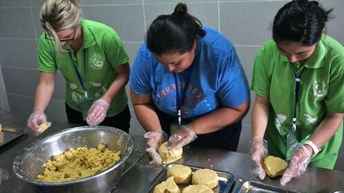 women preparing something from dough in chengdu