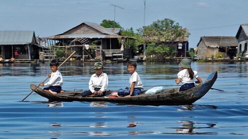 children in a boat in cambodia