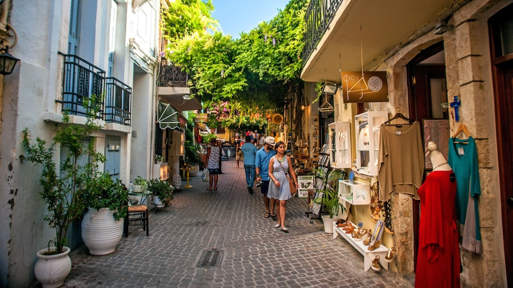 Show item 1 of 5. walking through the street retail in Greece