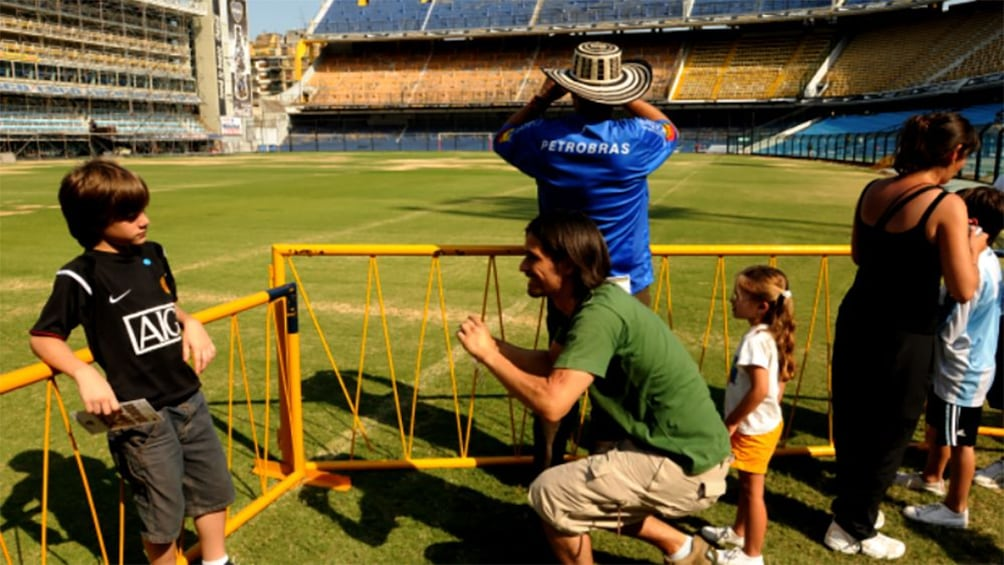 Tourists take pictures of La Bombonera Stadium