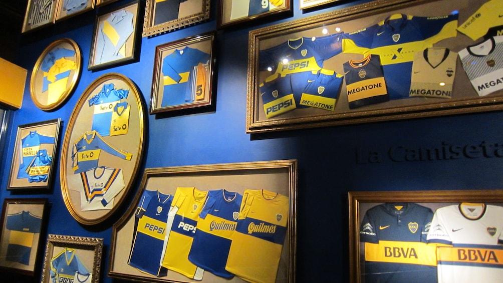 A collection of Jerseys on the wall in La Bombonera Stadium