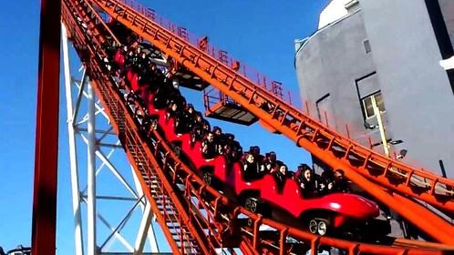 Roller coaster full of people plummets past