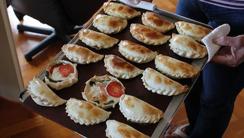 Mini pies on a cookie sheet