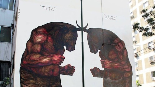 Two Minotaurs boxing tagged on the side of a building