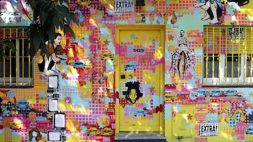 The side of a building covered in multi-colored graffiti.