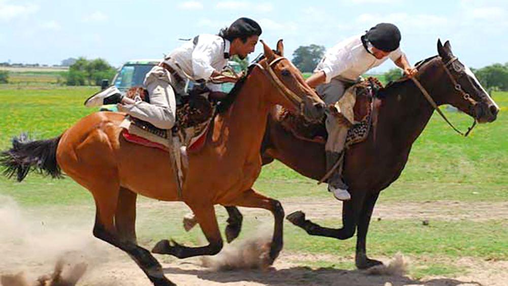 Two men ride on horseback