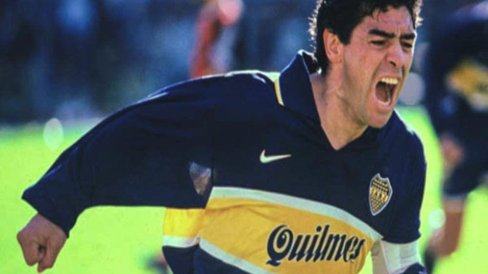Diego Maradona playing on the soccer field.