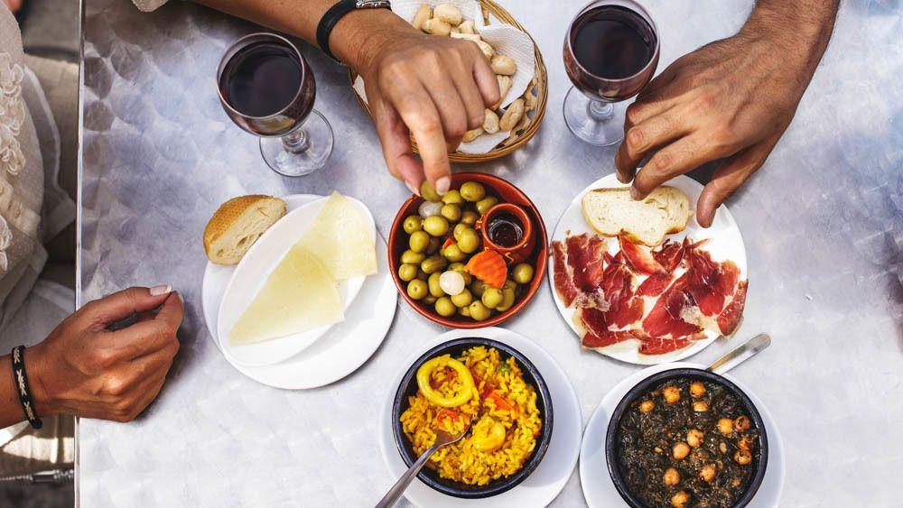 Food and wine prepared on table.