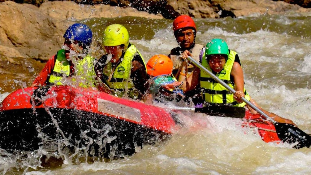 Show item 1 of 5. View of group on the exciting river rafting trip in Chiang Mai