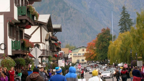 Street view of Alpine Village inhabited by several people.