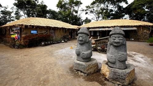 Stone statues in a village on Jeju Island South Korea