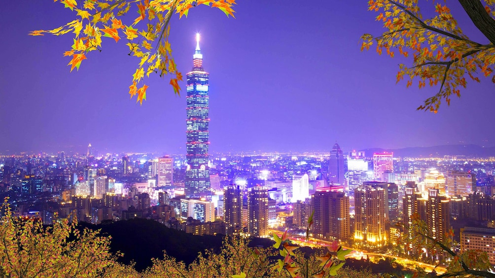 Show item 4 of 6. Purple skies overlooking the city at night in Taipei