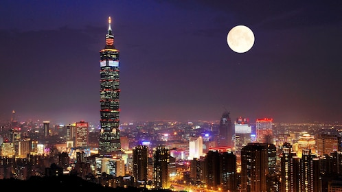 Gorgeous view of a full moon at night overlooking the city of Taipei