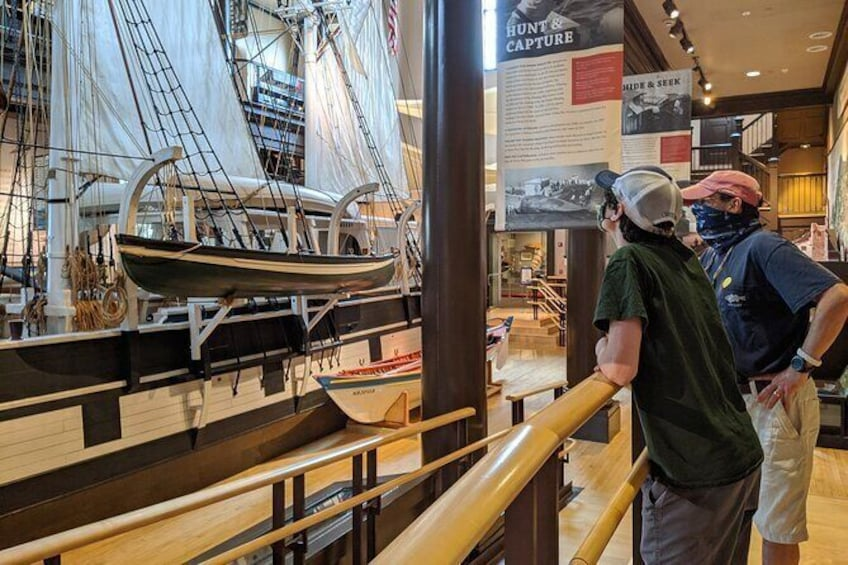 Show item 4 of 7. Visitors admire the Lagoda, a half-scale model of a 19th Century whaleship and the largest model ship in the world.