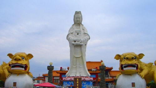 Close view of the statues outside a temple in Taipei