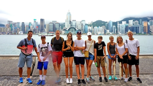 group standing by the water in Hong Kong