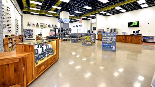 Interior view of brightly lit gun shop.