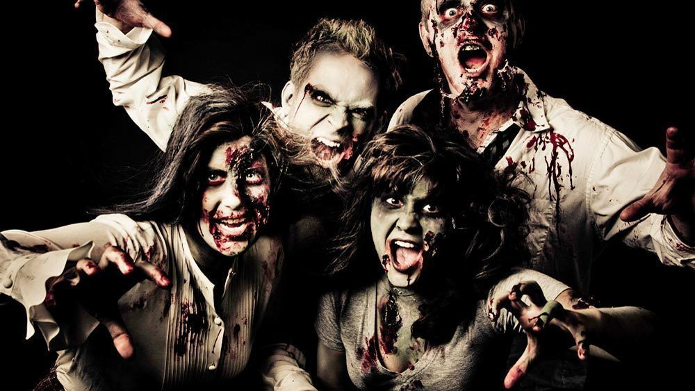 Group shot of men and women in zombie costumes.