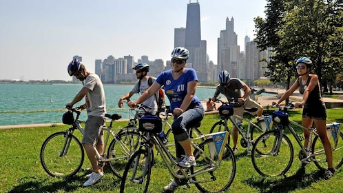 bikers resting their legs on park grass in Chicago