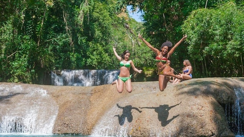 Ladies jumping into a pool in Jamaica