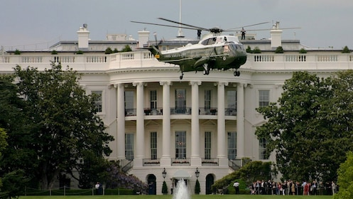 Close up of White House with helicopter flying in front.
